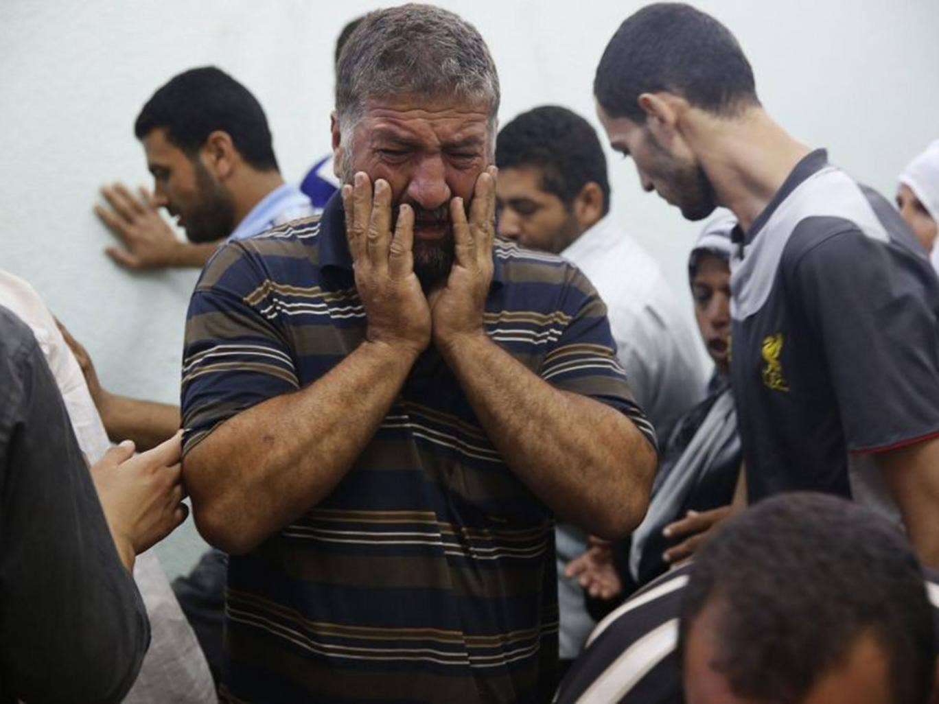 A Palestinian man mourns a relative who medics said died in Israeli shelling during the Israeli ground offensive