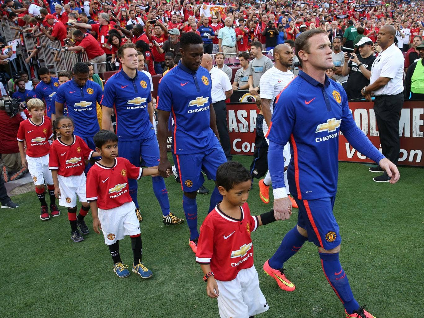 The Manchester United team walk out ahead of the pre-season friendly between Manchester United and Inter Milan at FedExField