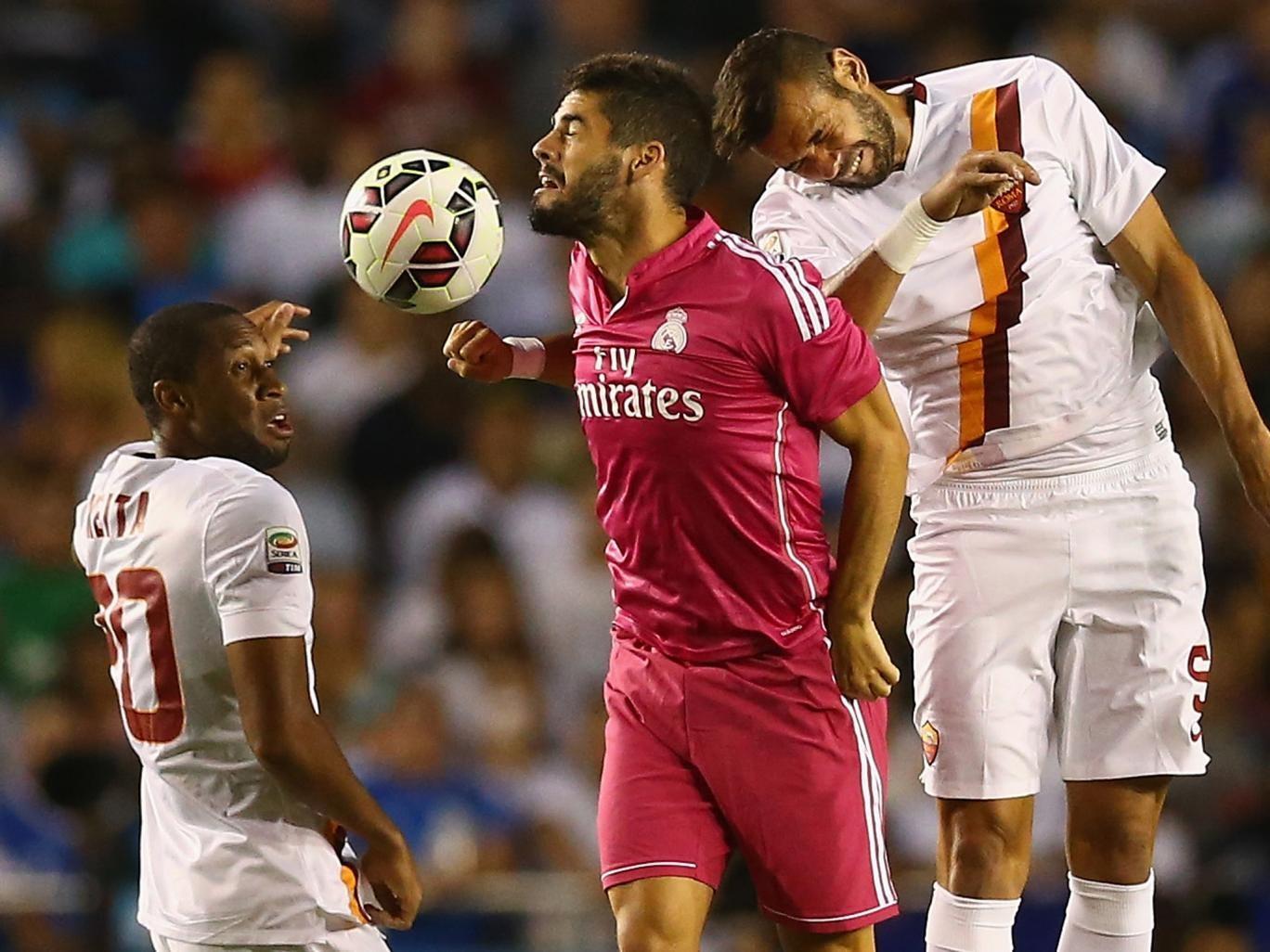Seydou Keita (left) in action against Real Madrid