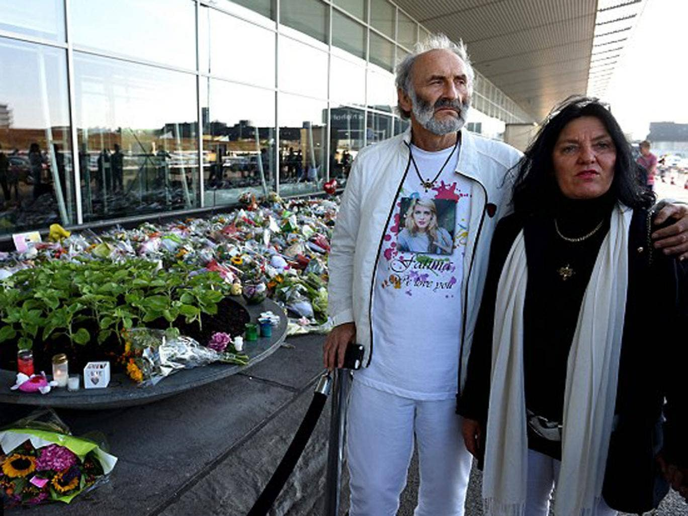 George and Angela Dyczynski the parents of 25-year-old only child Fatima Dyczynski stand outside the airport