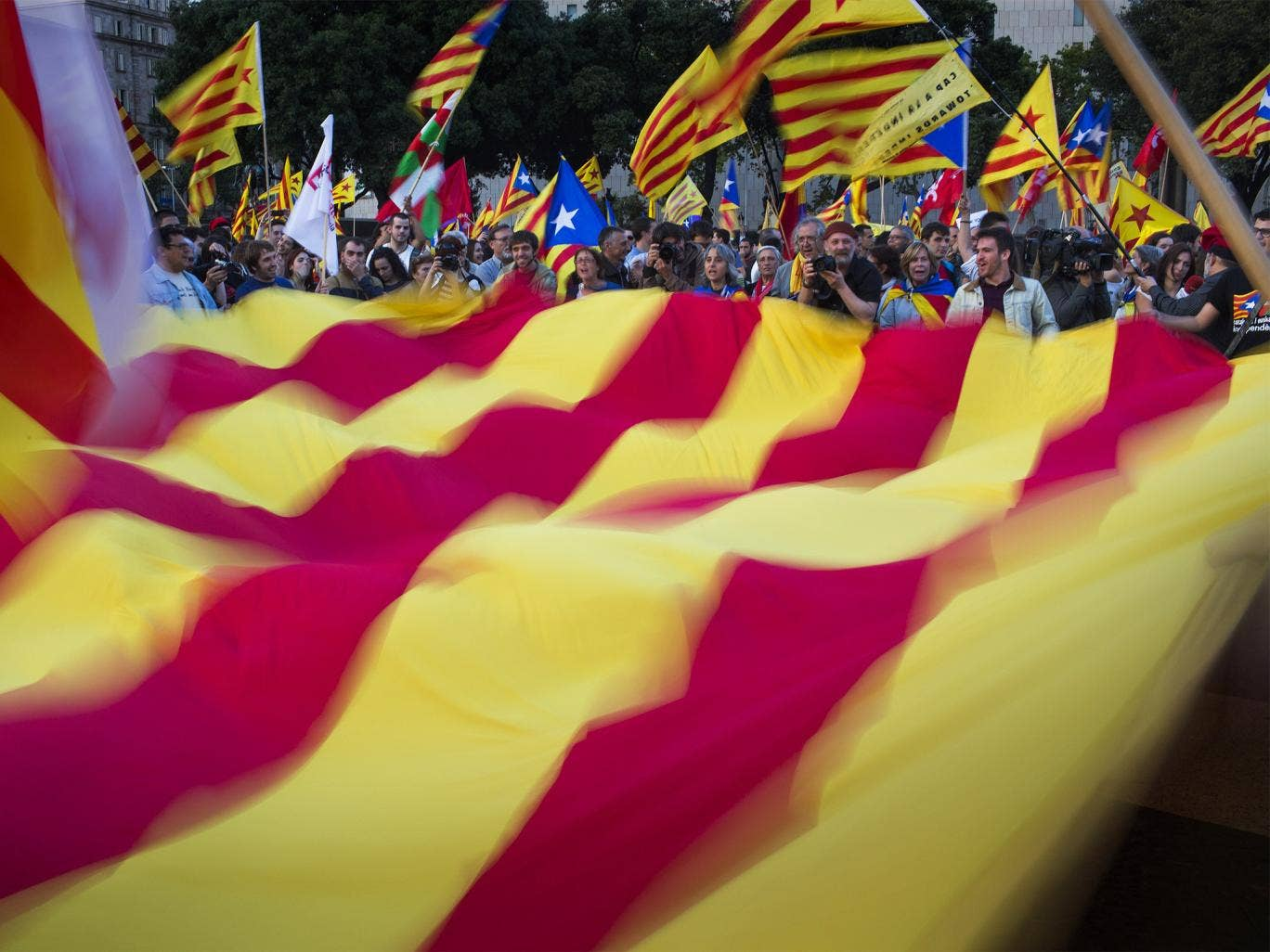 """Catalan demonstrators wave a pro-independence """"estelada"""" flag during a protest in Barcelona last month"""
