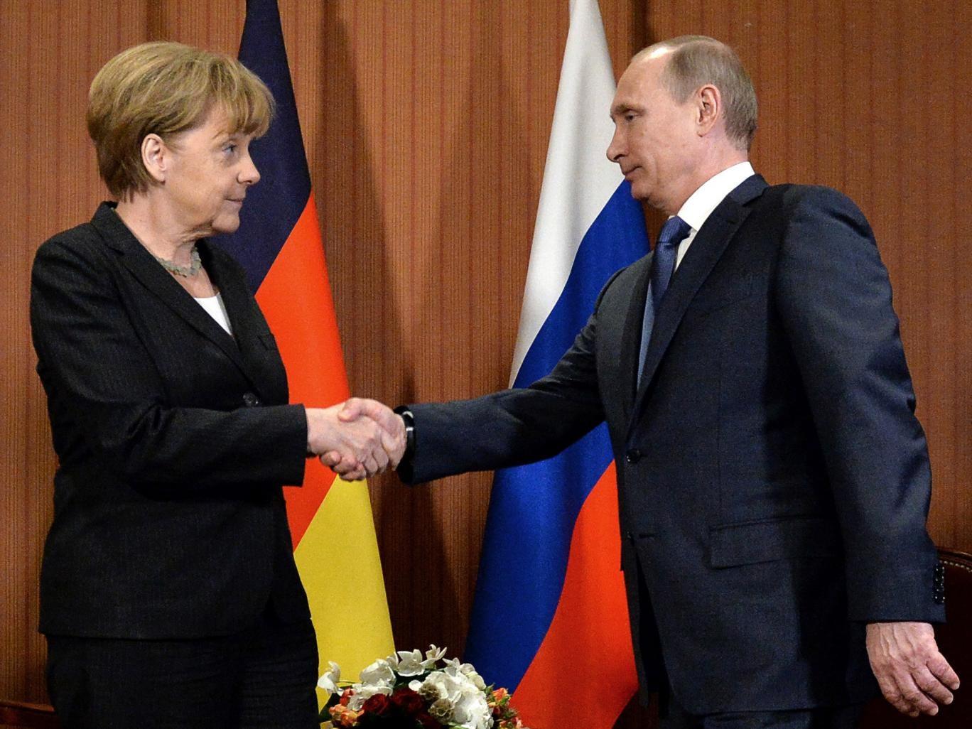 Russian President Vladimir Putin shakes hand with German chancellor Angela Merkel, during a meeting last month