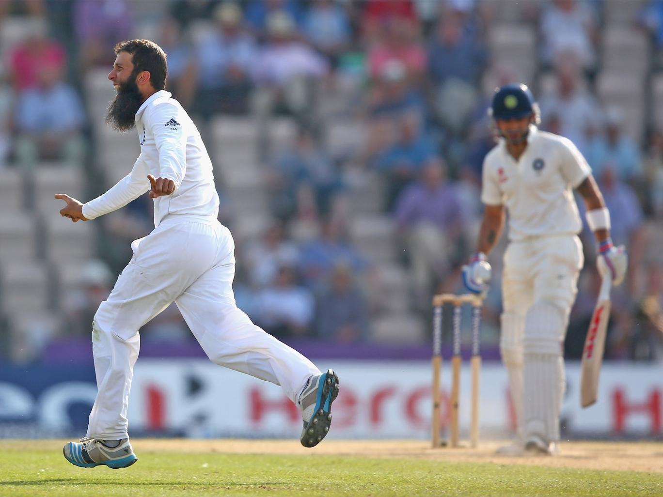 Moeen Ali of England celebrates capturing the wicket of Virat Kohli