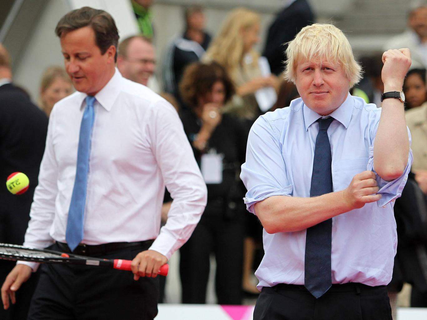 Prime Minister David Cameron and Mayor of London Boris Johnson warm up for a tennis match during the International Paralympic Day at Trafalgar Square on September 8, 2011 in London, England.