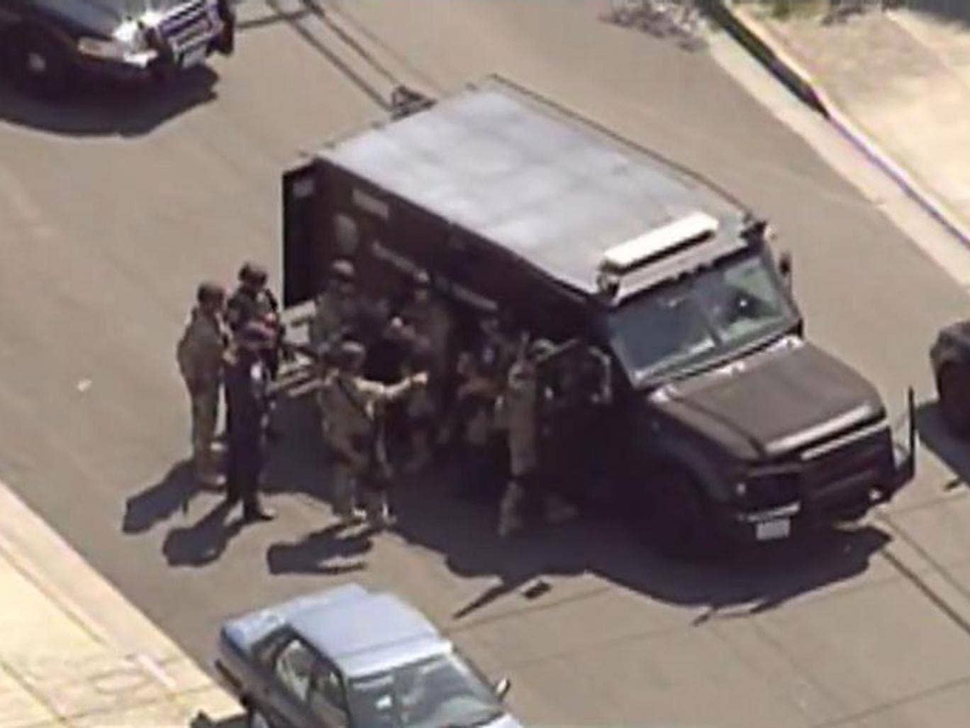 The SWAT team outside of the property in Hayward
