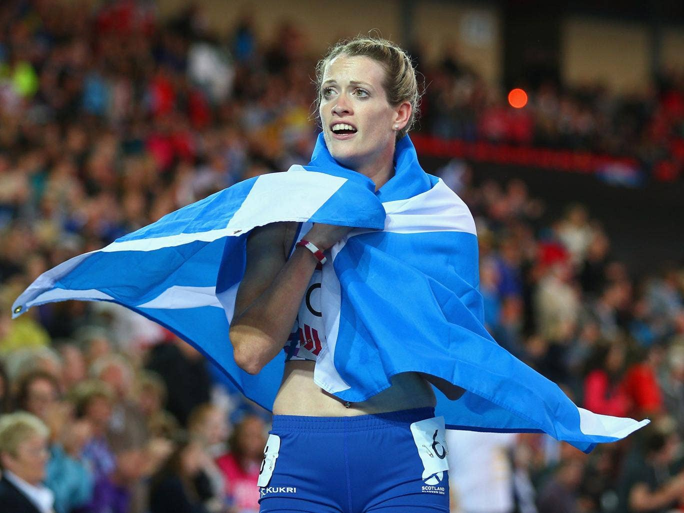 Eilidh Child embarks on a lap  of honour after coming second in the 400m hurdles
