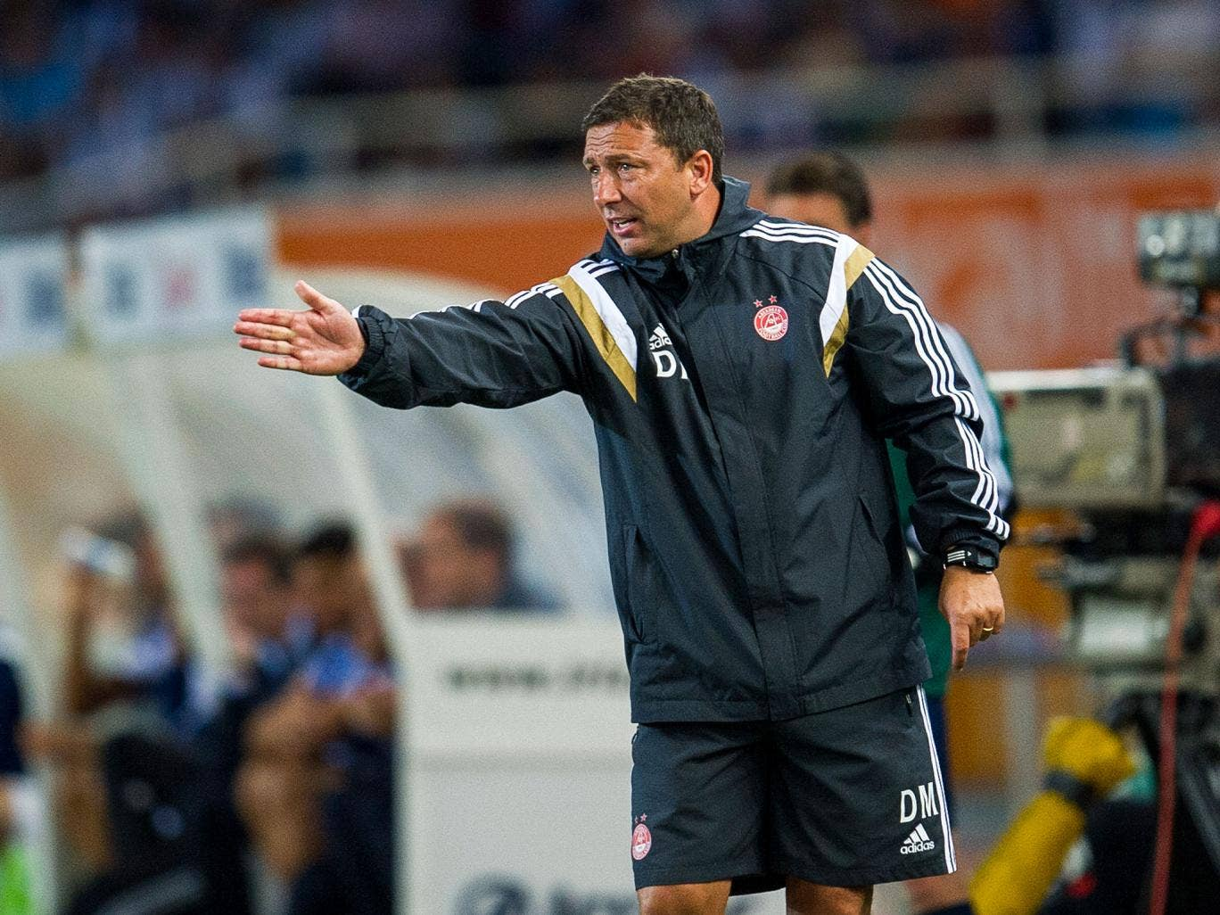 Dereck McInnes  gestures from the sidelines during Aberdeen's 2-0 loss to Real Sociedad