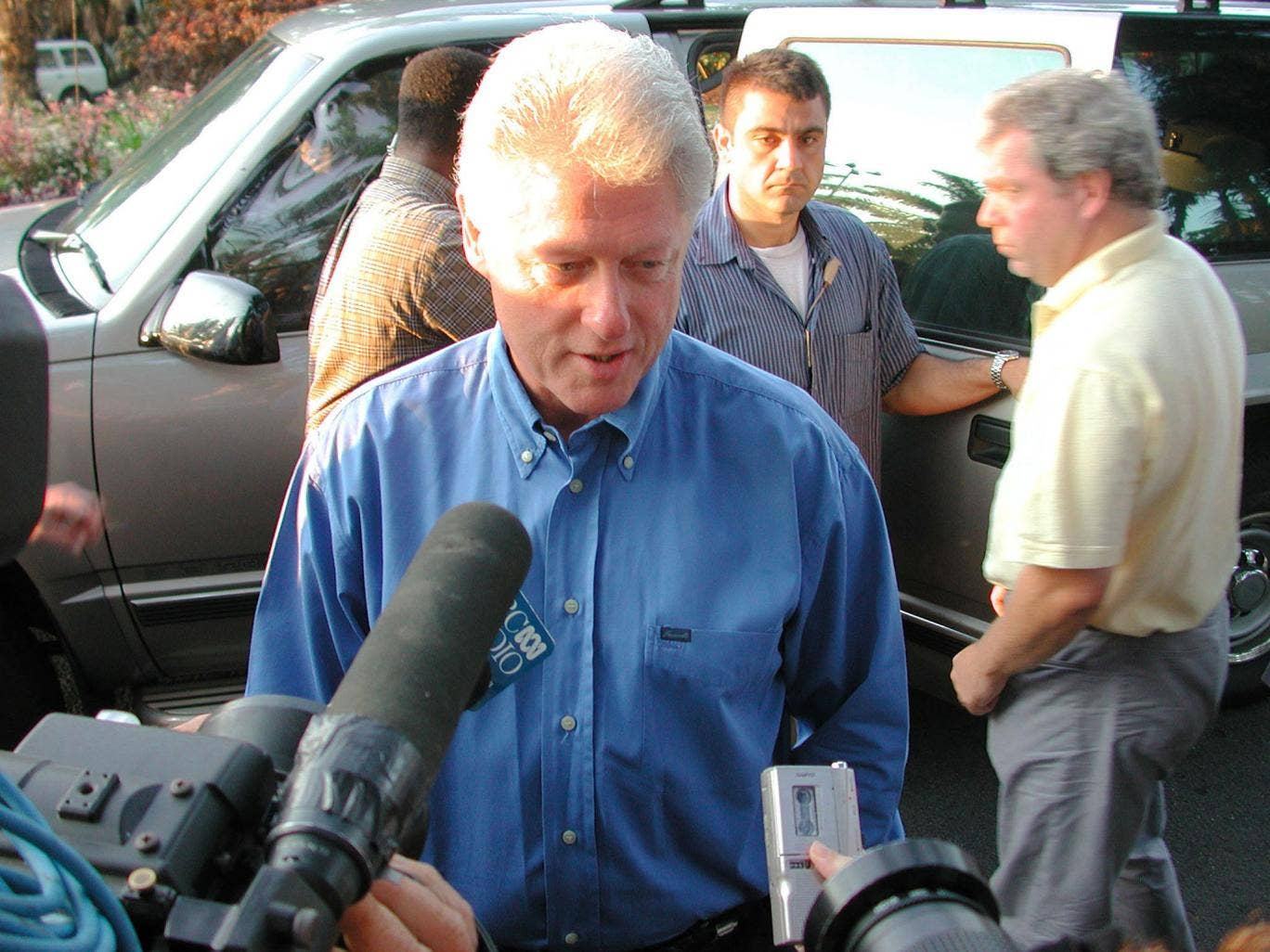 Former U.S. President Bill Clinton speaks with the media during a press conference September 12, 2001