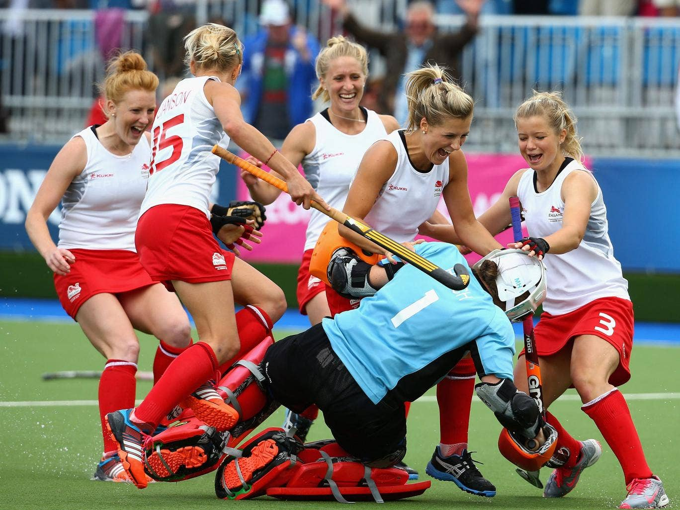 England goalkeeper Maddie Hinch is mobbed after her shoot-out heroics