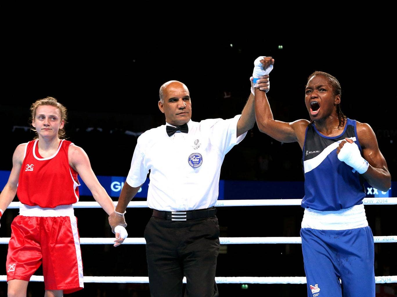 Nicola Adams celebrates winning gold after beating Michaela Walsh of Northern Ireland