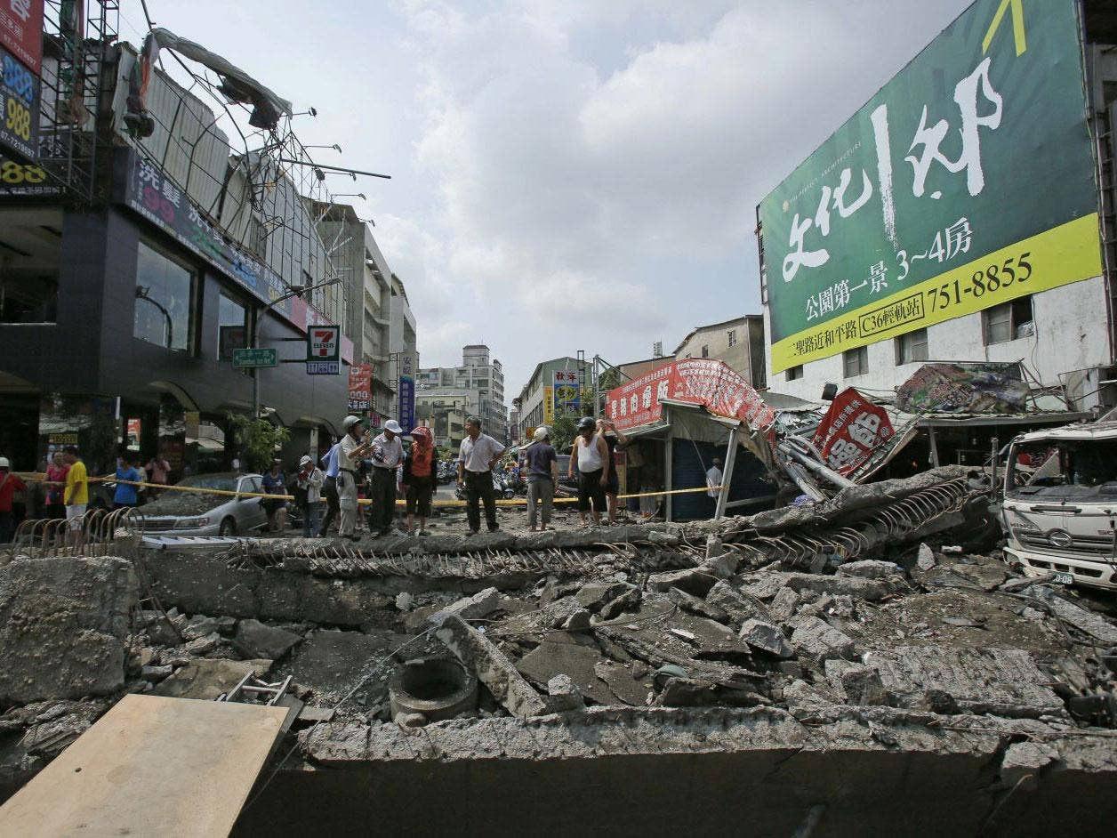 Locals survey the damage from massive gas explosions in Kaohsiung, Taiwan