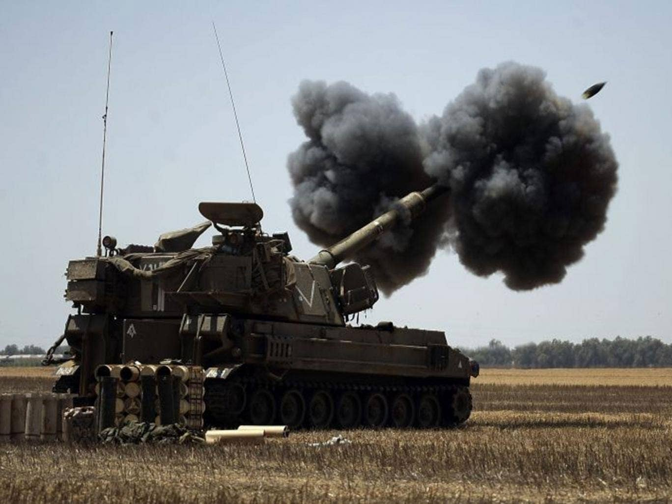 An Israeli canon fires a shell towards targets in the Gaza Strip on 2 August