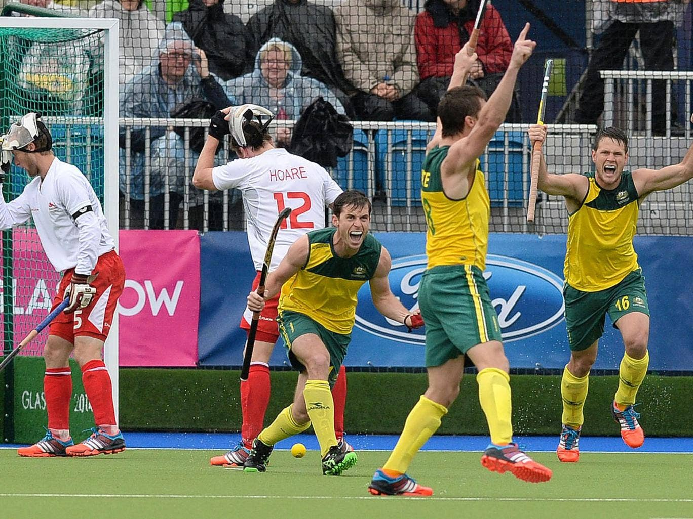 Australia players raise their arms in delight as another goal puts the match beyond England and a place in the final is secured