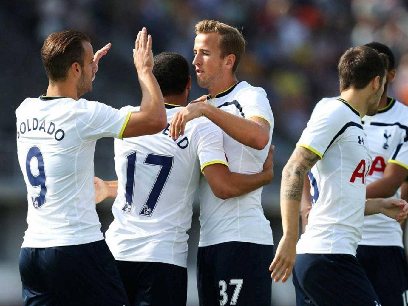 Harry Kane celebrates scoring the first goal for Tottenham with Roberto Soldado and team mates