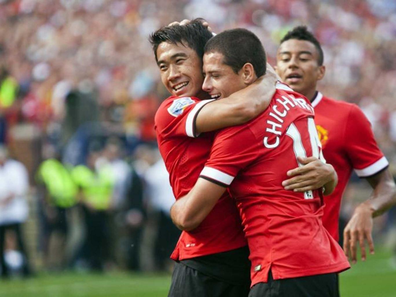 Shinji Kagawa, left, celebrates his assist for a goal from forward Javier Hernandez