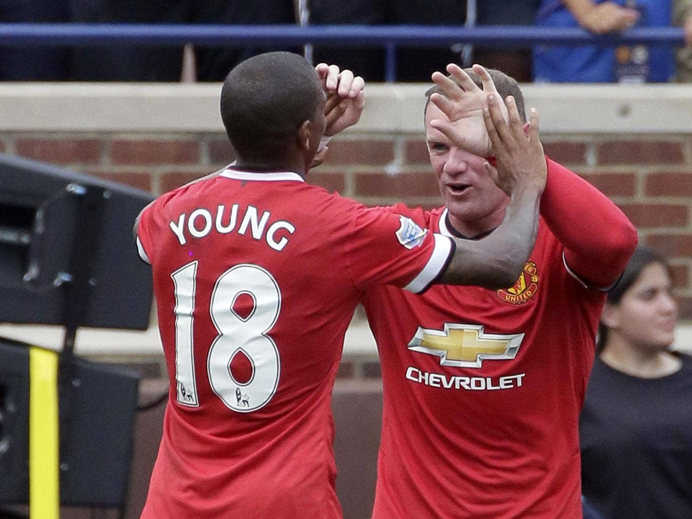 Ashley Young and Wayne Rooney celebrate the opening goal in Ann Arbor