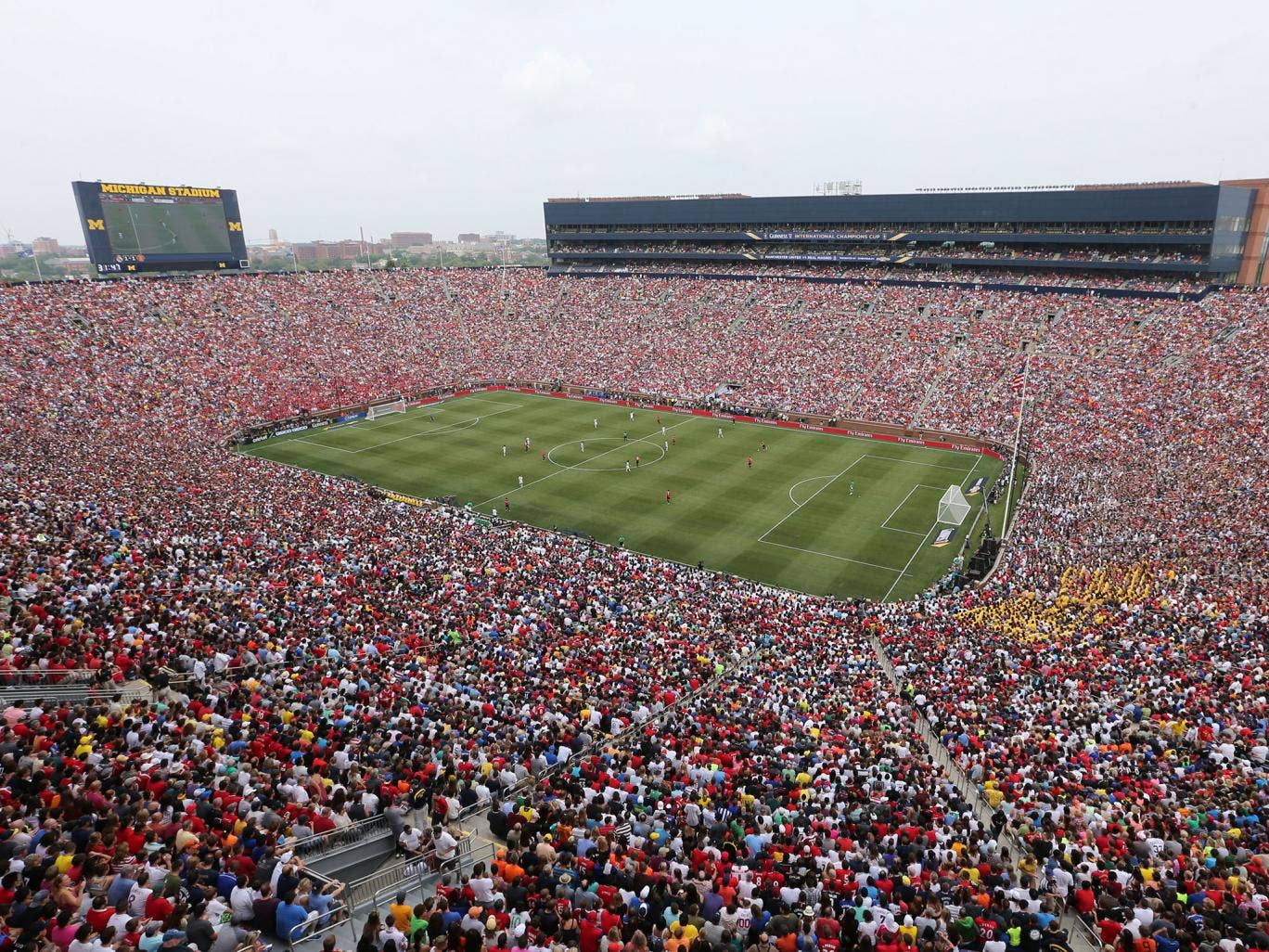 A record crowd for a US soccer match of 109,318 watched Manchester United play Real Madrid in Michigan