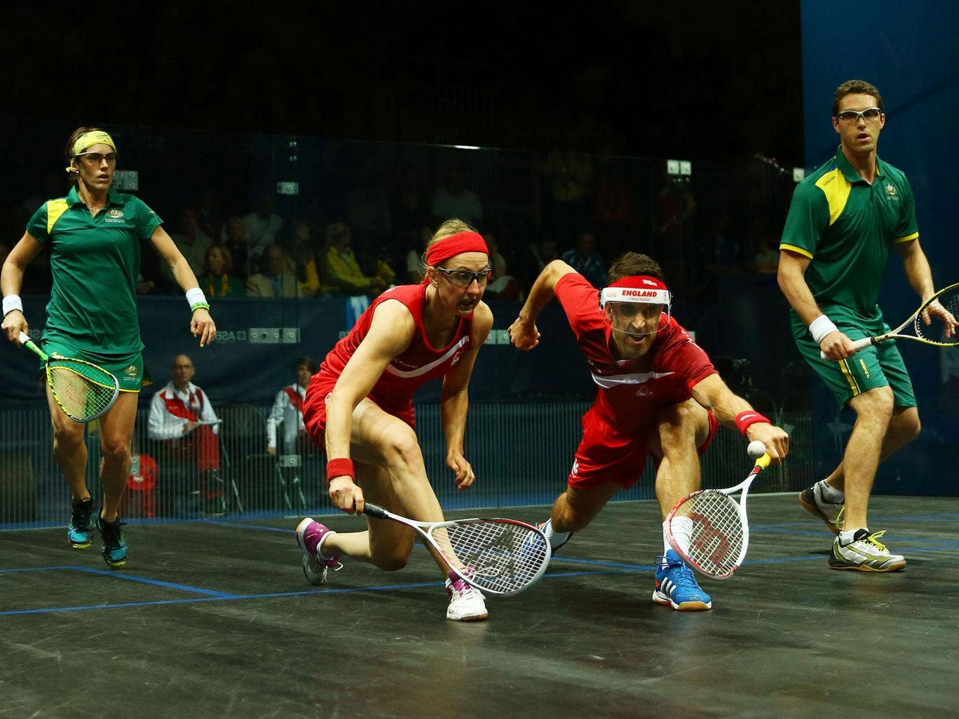 England's Peter Barker and Alison Waters (red kit) were beaten by David Palmer and Rachael Grinham, of Australia