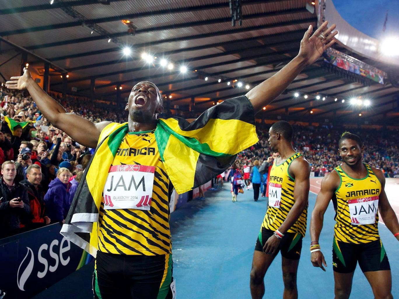 Usain Bolt plays up to the Glasgow crowd after his gold medal in the relay