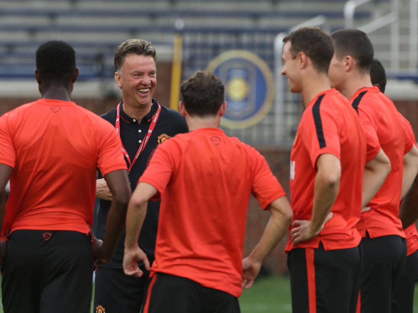 Louis van Gaal shares a joke with his Manchester United squad during training
