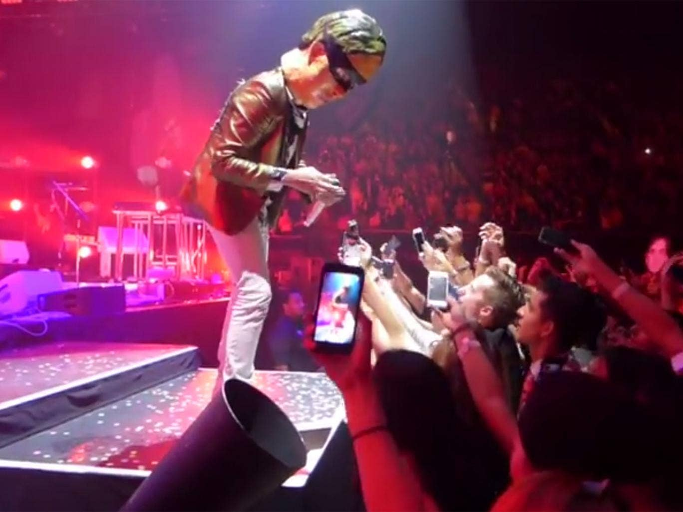Win Butler of Arcade Fire 'steals' mobile phones from fans