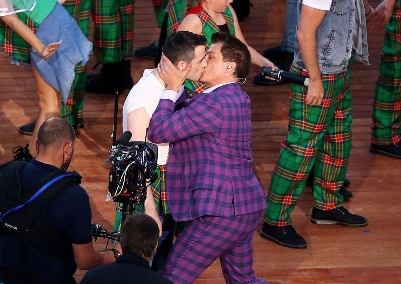 """John Barrowman kisses his male """"bride"""" at a mock Gretna Green during the Commonwealth Games opening ceremony"""