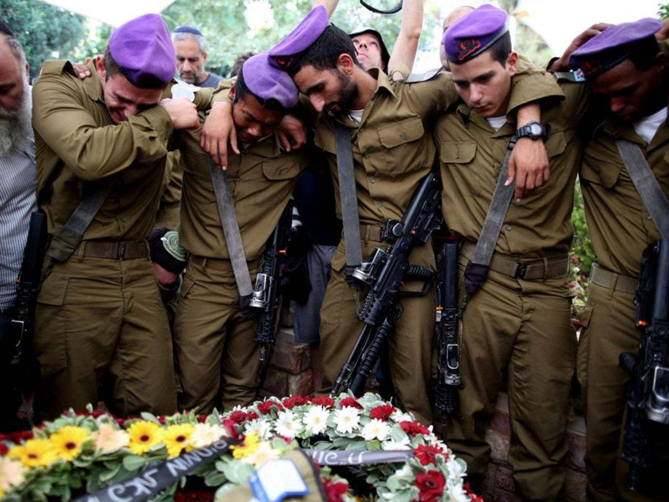 Fellow soldiers were among the 10,000 people who attended the funeral of Lt Hadar Goldin