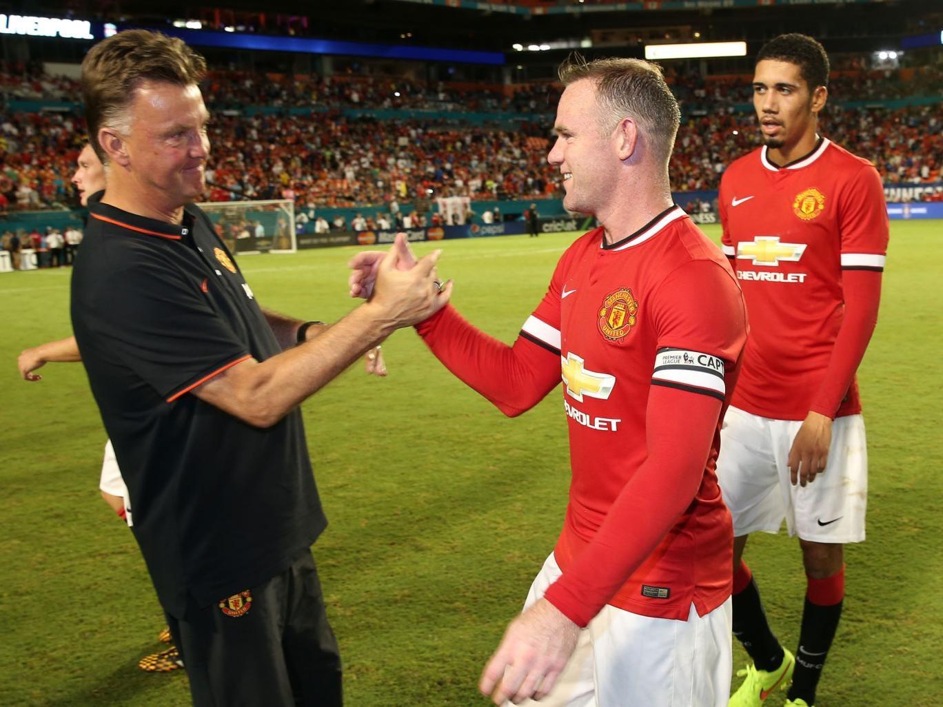Louis van Gaal shakes Rooney's hand at full time