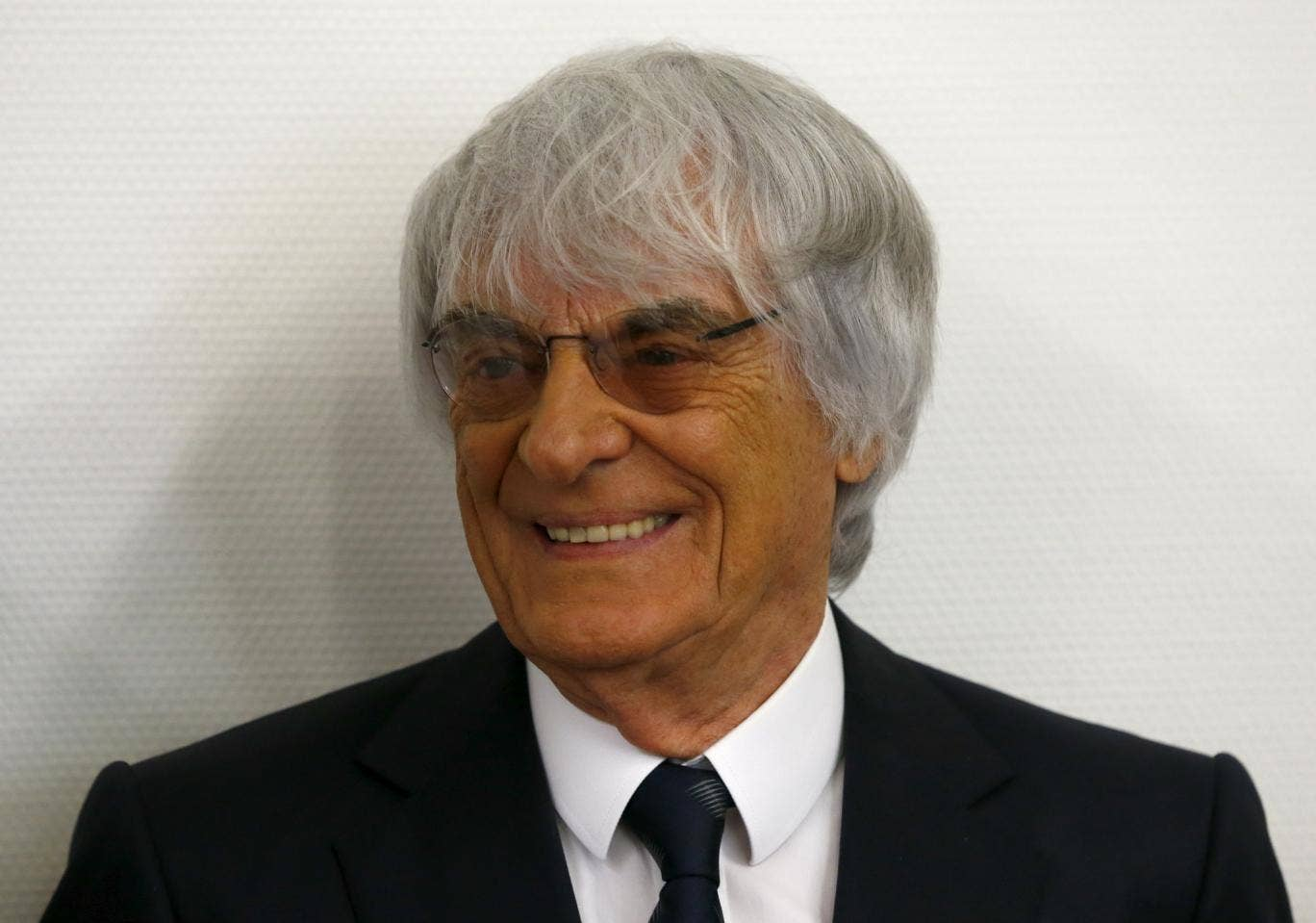 F1 boss Bernie Ecclestone has had his bribery case thrown out of court after making a one-off payment of $100m