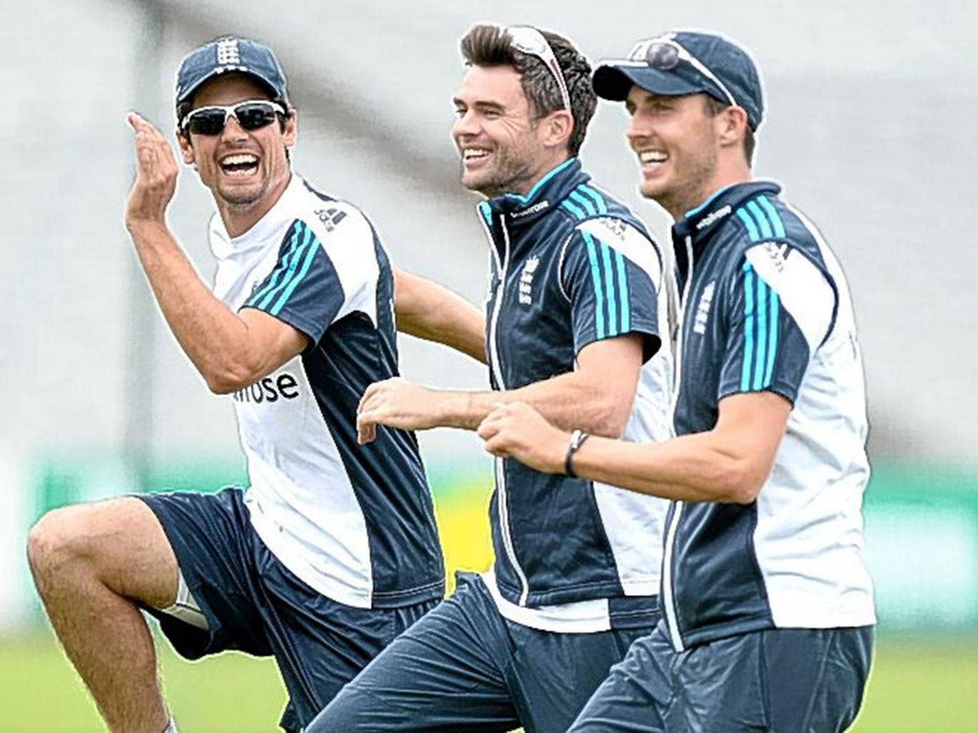 England's (from left) Alastair Cook, Jimmy Anderson and Steven Finn share a joke during a nets session in Manchester