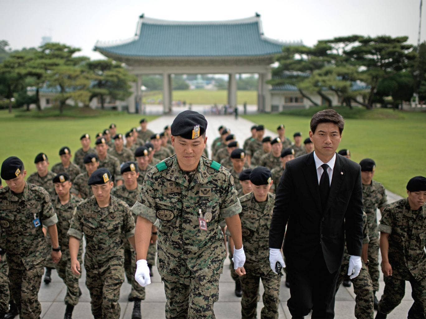 Soldiers pay their respects in June on the anniversary of the start of the Korean War. Many South Korean recruits are struggling with conscript life