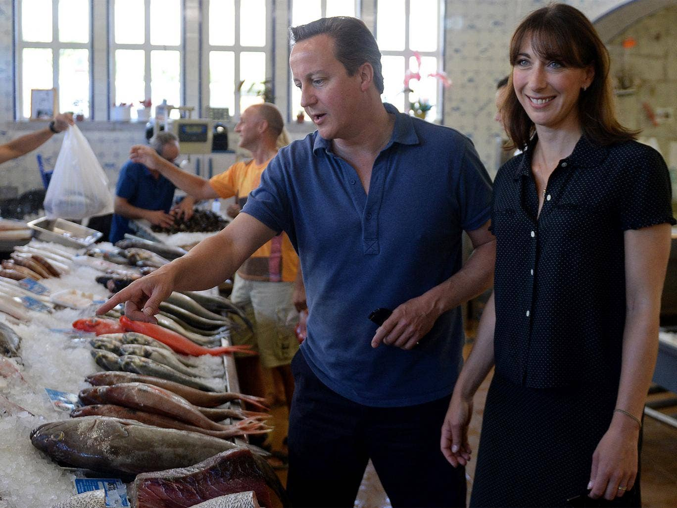 Prime Minister David Cameron  and his wife Samantha are pictured as they visit a seafood market in Cascais in Portugal, on August 5, 2014
