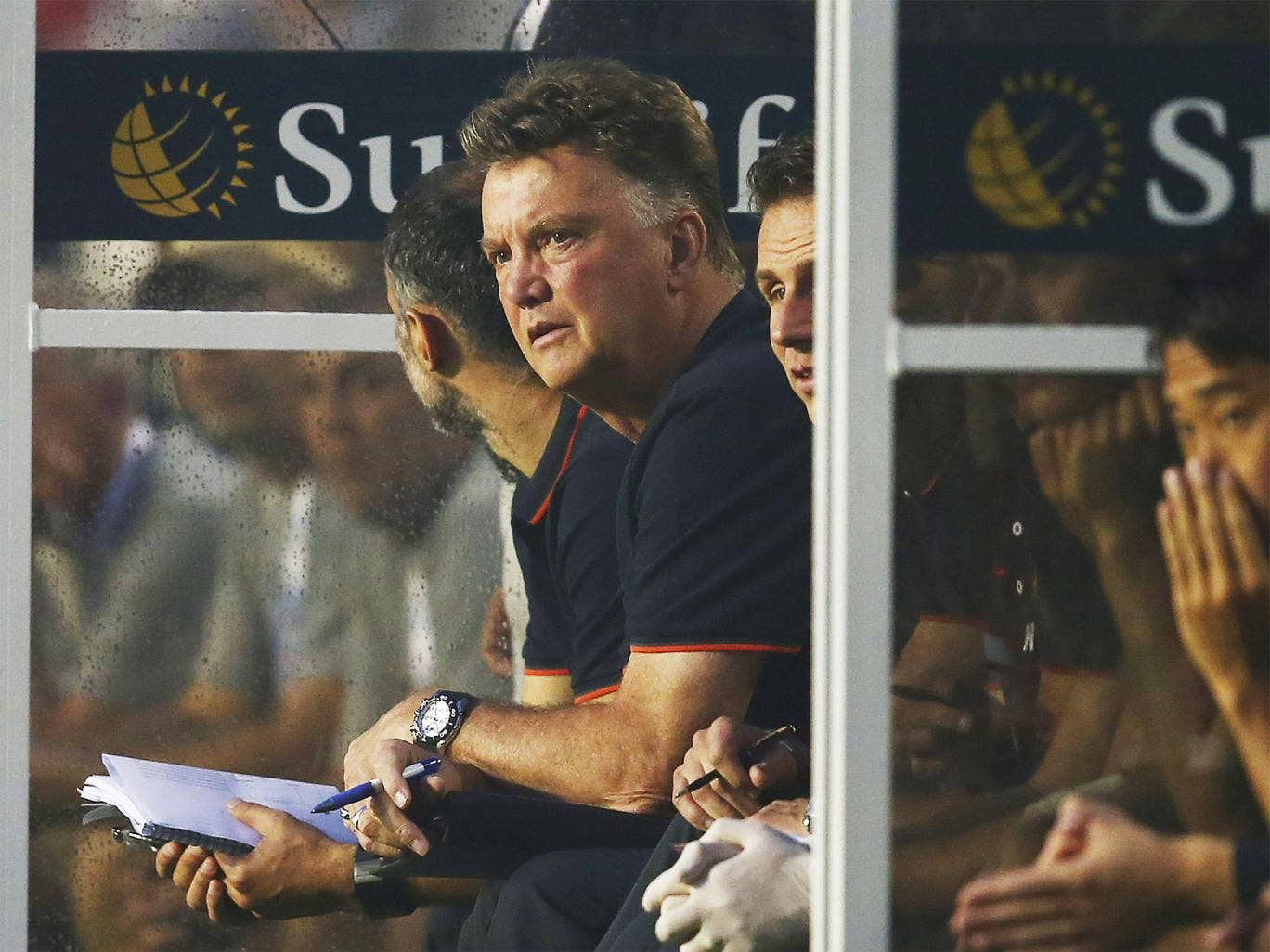 Louis van Gaal watches on from the bench during Manchester United's victory over Liverpool in Miami
