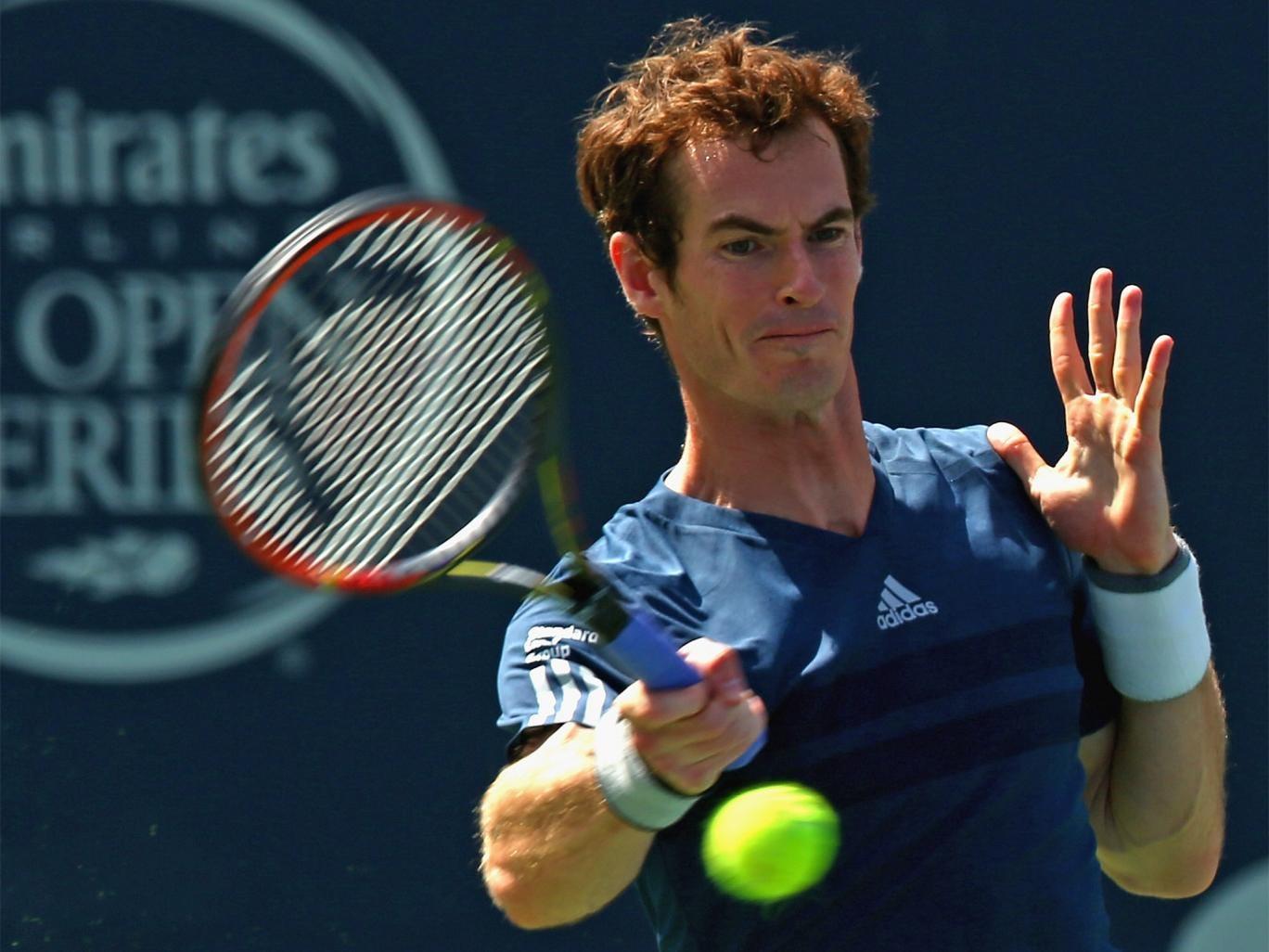 Britain's Andy Murray returns a shot to Australia's Nick Kyrgios in Toronto