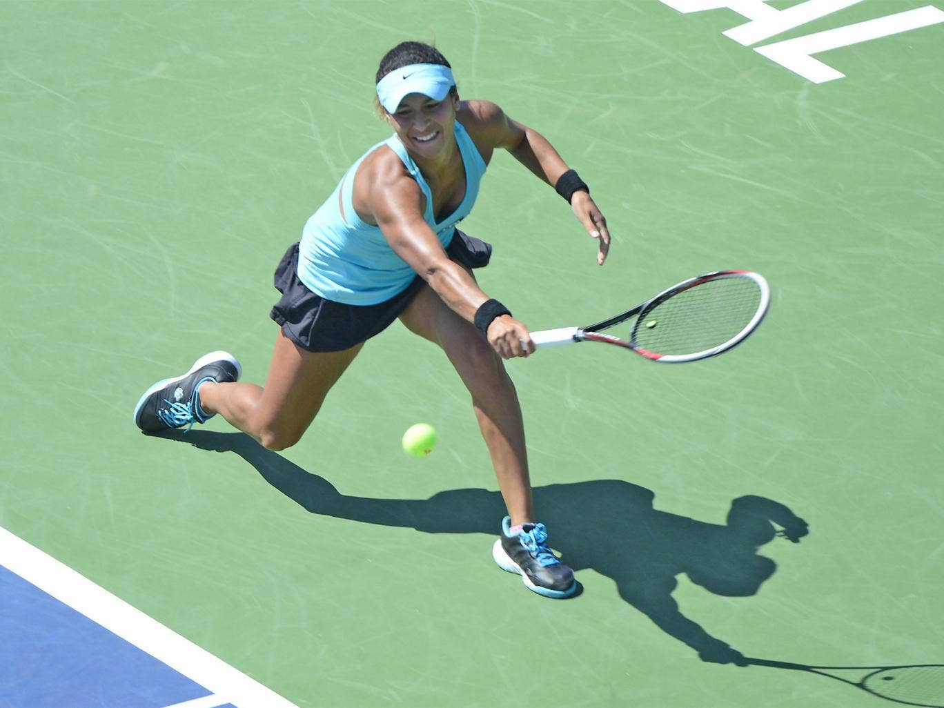 Heather Watson plays stretches for a backhand on her way to beating Dominika Cibulkova