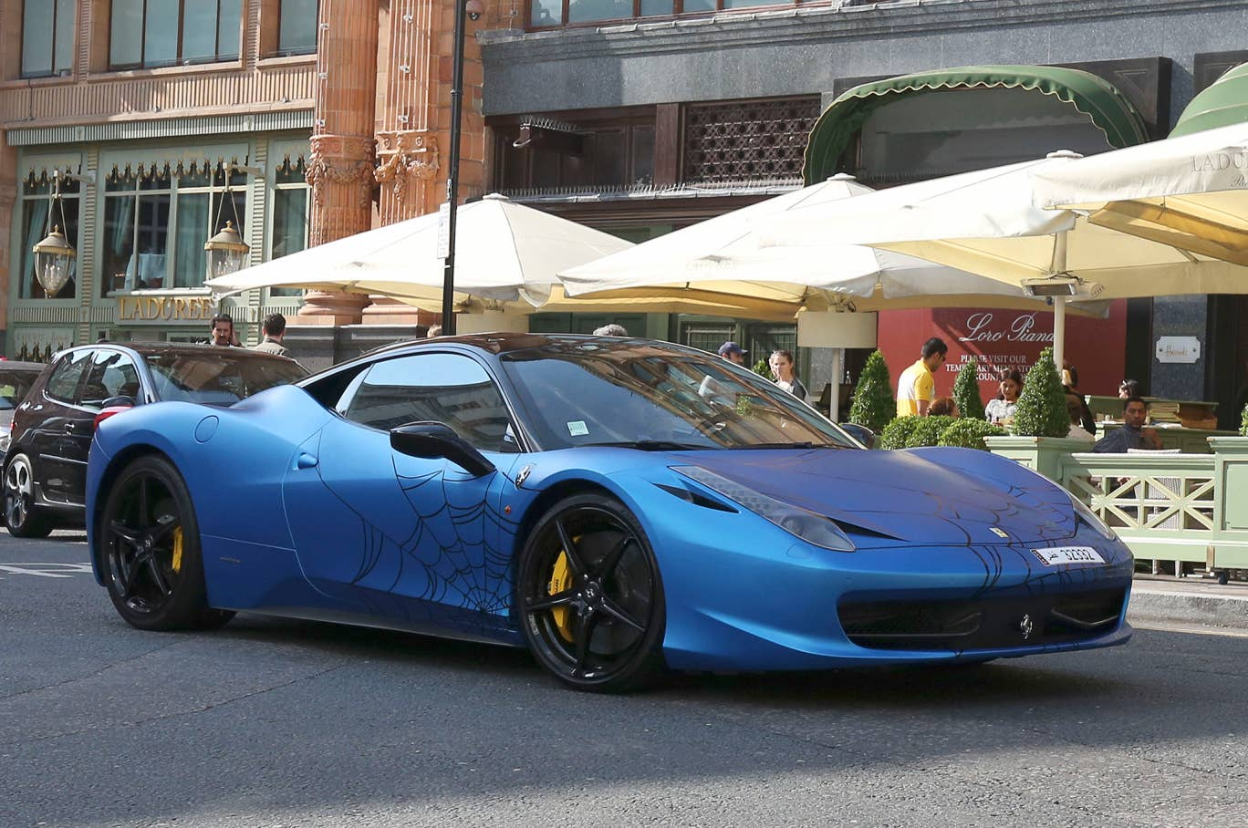A Ferrari 458 with custom bodywork outside Harrods in Knightsbridge