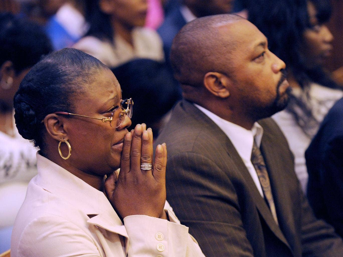 Monica McBride, mother of Renisha McBride, cries during the reading of verdict of guilty of of second-degree murder and manslaughter for Theodore Wafer. Walter Ray Simmons, Renisha's father, is by her side