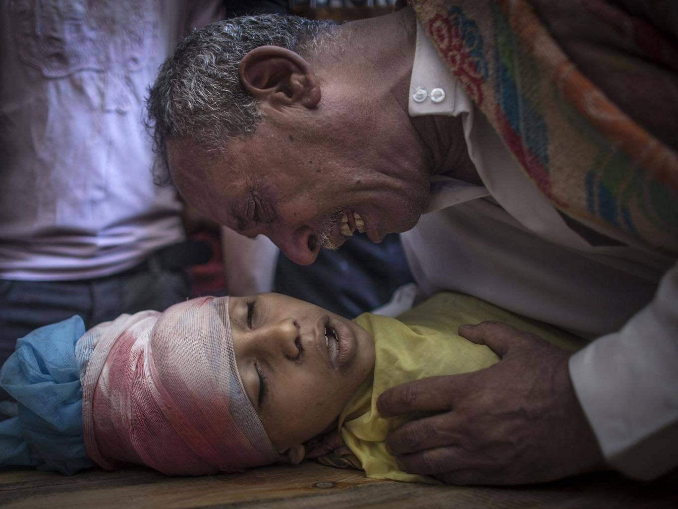 The father of 10-year-old Ibraheem al-Dawawsa cries over the dead body of his son in Gaza City