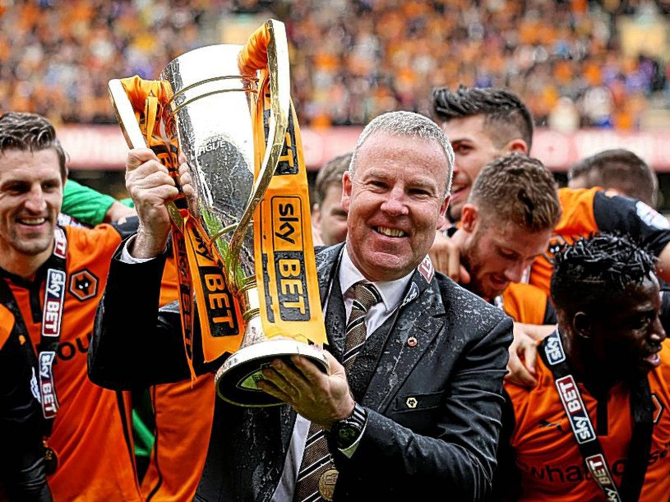 Kenny Jackett holds the League One trophy, won by Wolves with 103 points
