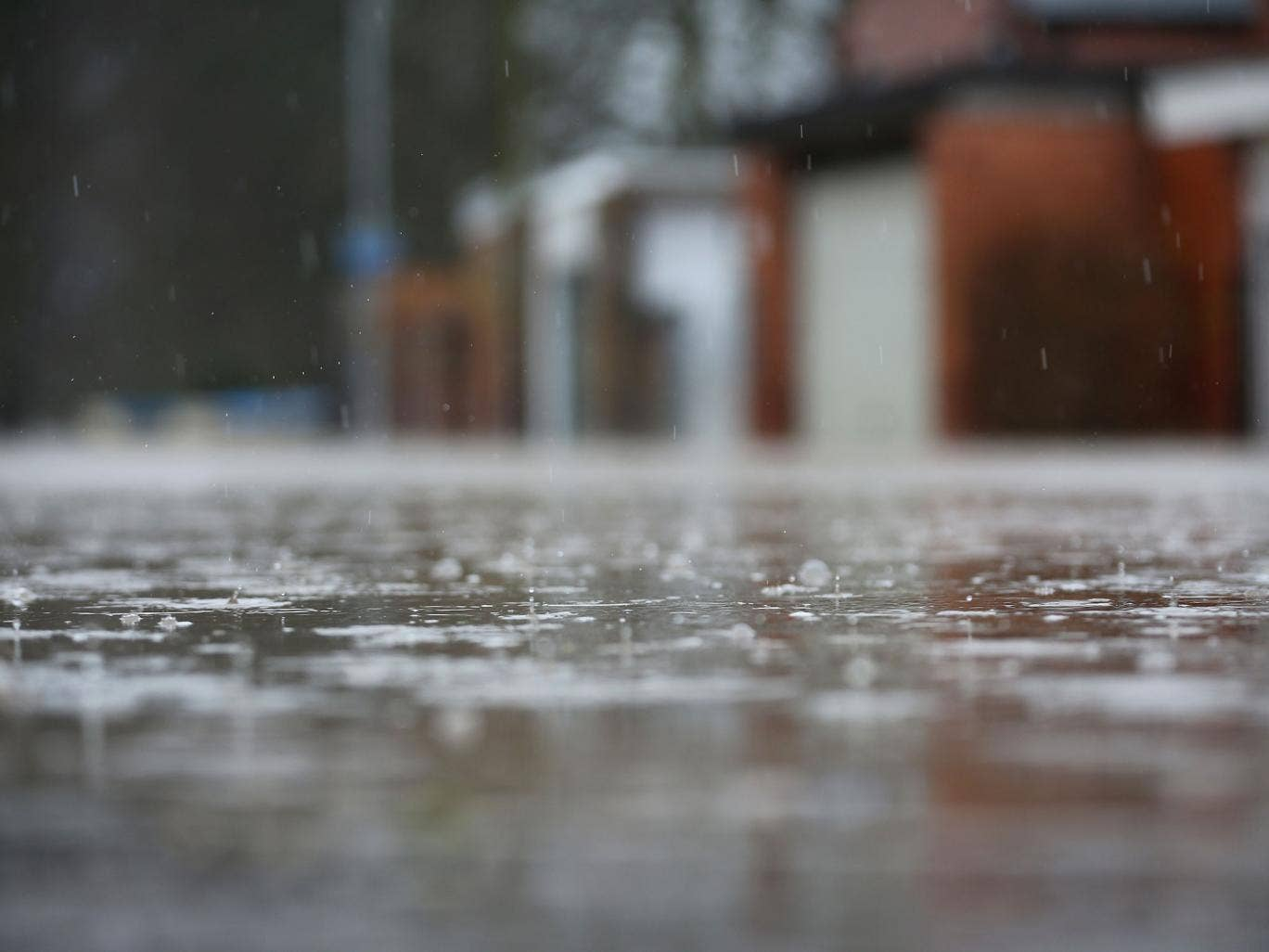 The rain continues to fall on a flooded street in Worcester on February 14, 2014 in Worcester, United Kingdom. Flood water has remained high in some areas and high winds are causing disruption to other parts of the UK with the Met Office issuing a red wea