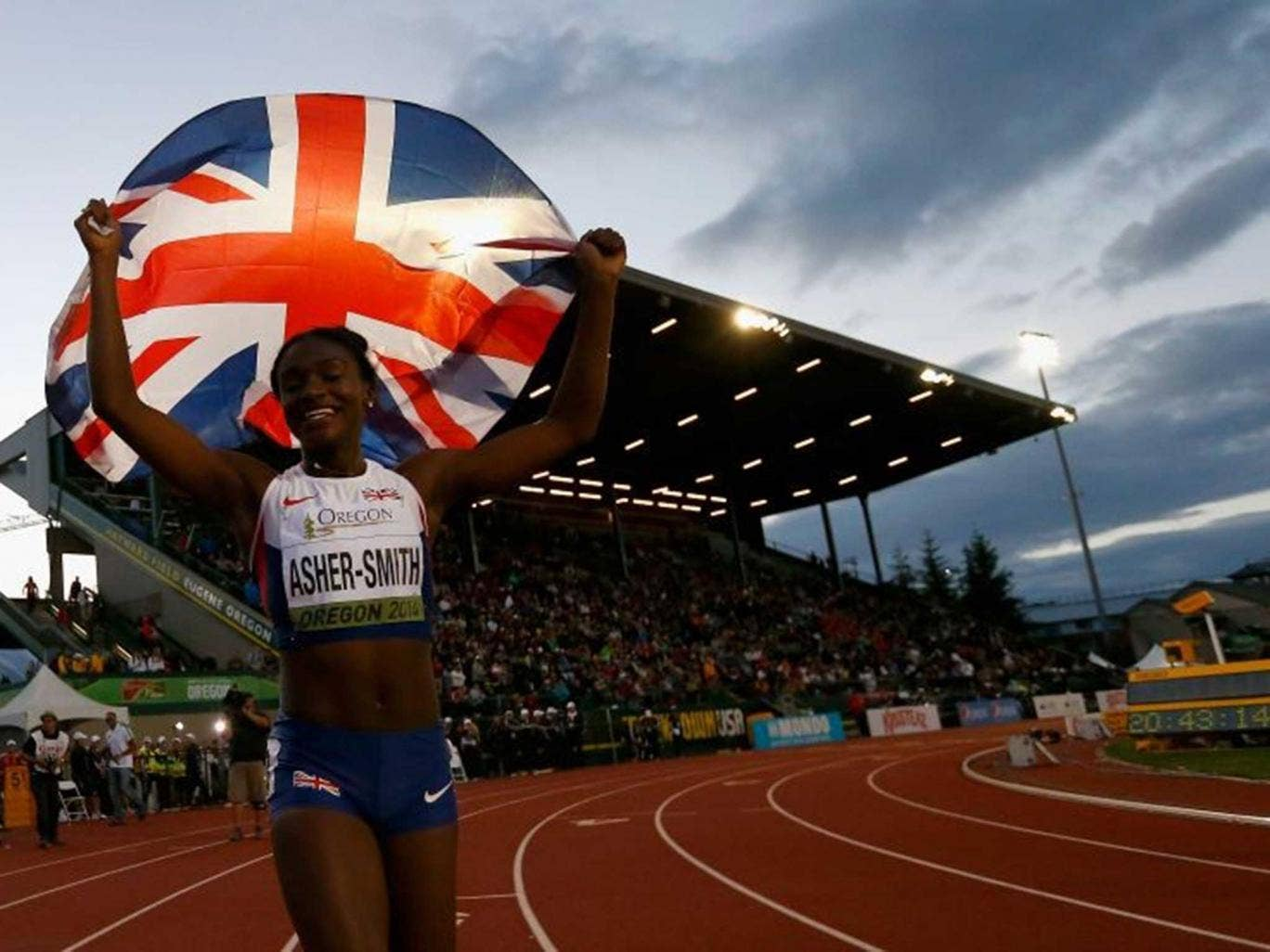 Golden girl: Dina Asher-Smith celebrates her win in the world junior championships in Oregon last month