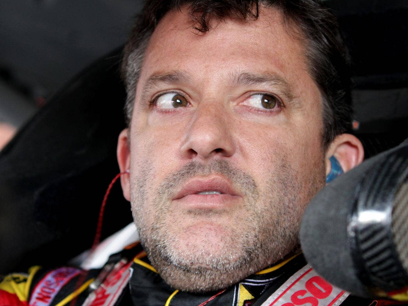 Tony Stewart, pictured sitting in his car during practice for the Nascar Sprint Cup Series at Watkins Glen, New York on 8 August  2014