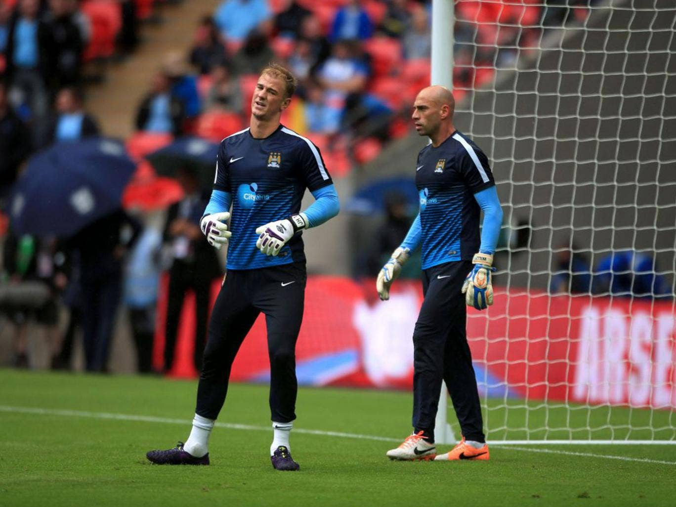 Joe Hart warms up alongside Willy Caballero before the Community Shield at Wembley