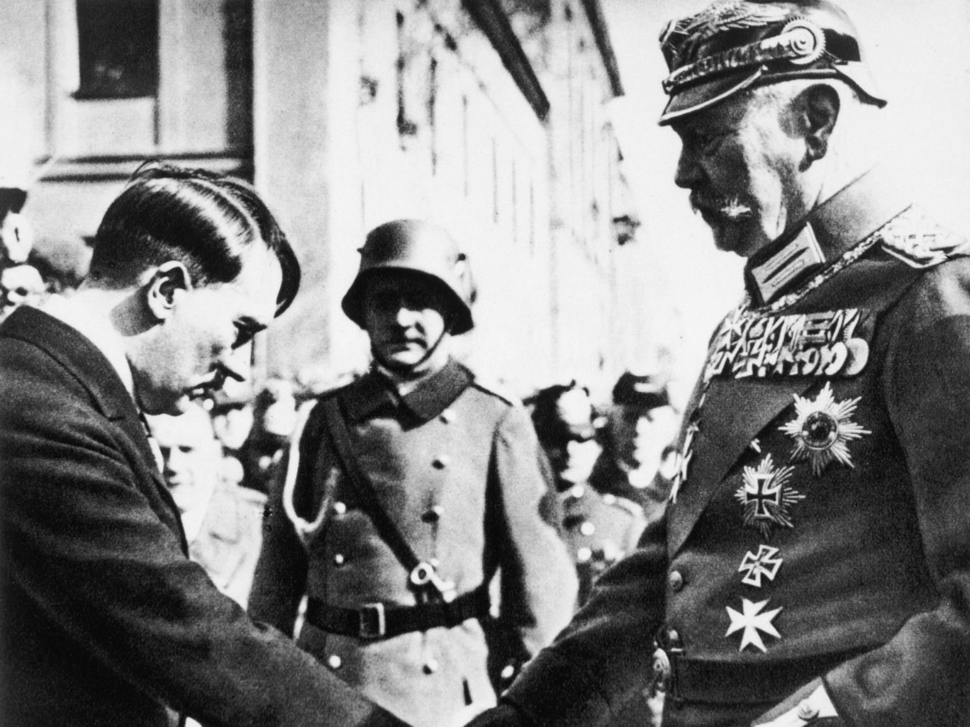 Paul von Hindenburg, the then President, shakes hands with Adolf Hitler at Potsdam's Garrison Church in 1933