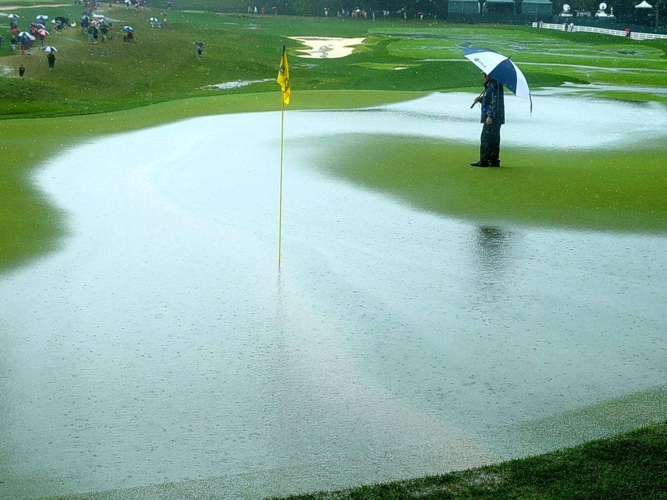 The heavily waterlogged ninth hole during today's downpour at Valhalla