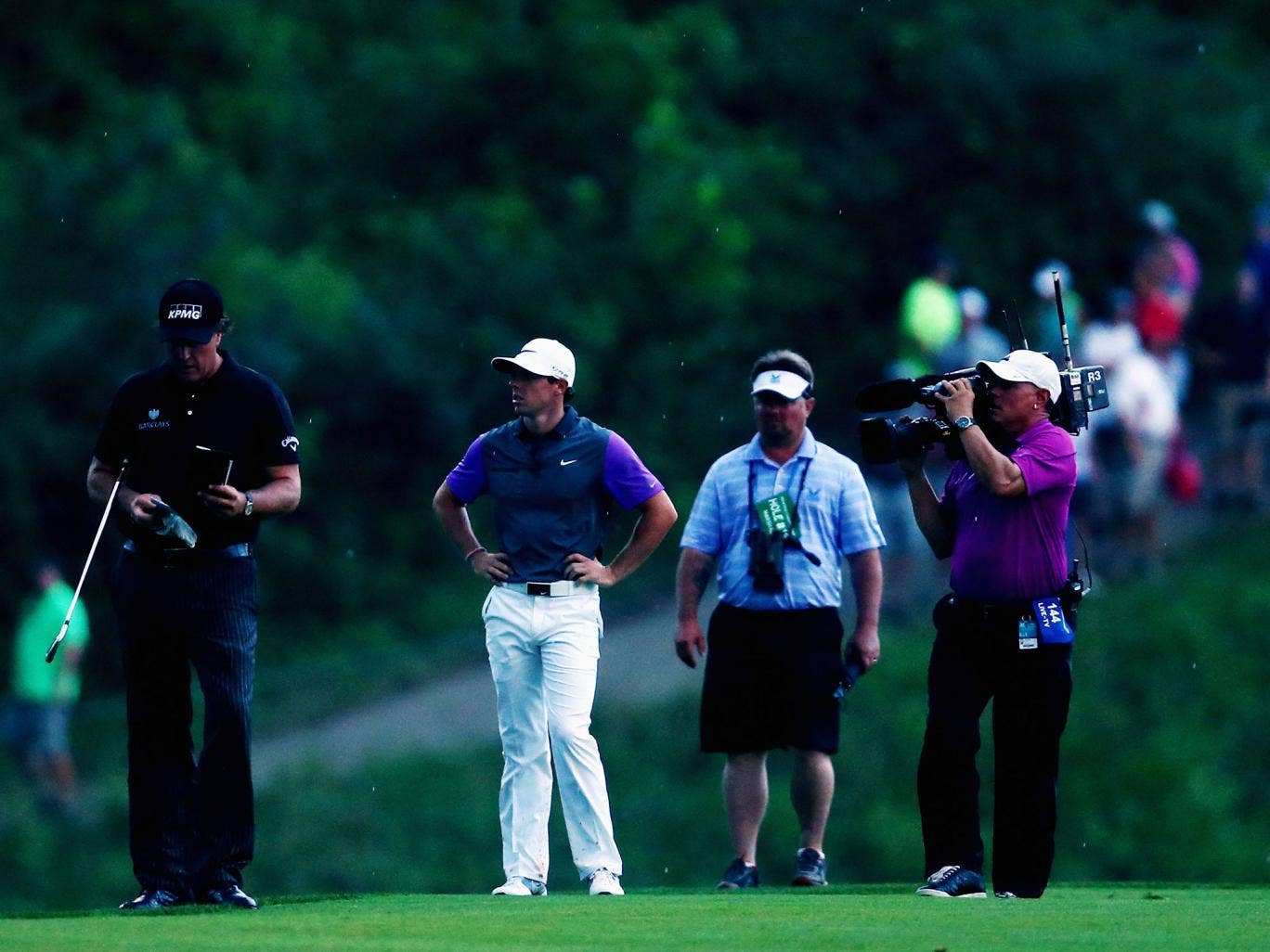 Phil Mickelson and Rory McIlroy stand together during the final round of the US PGA Championship