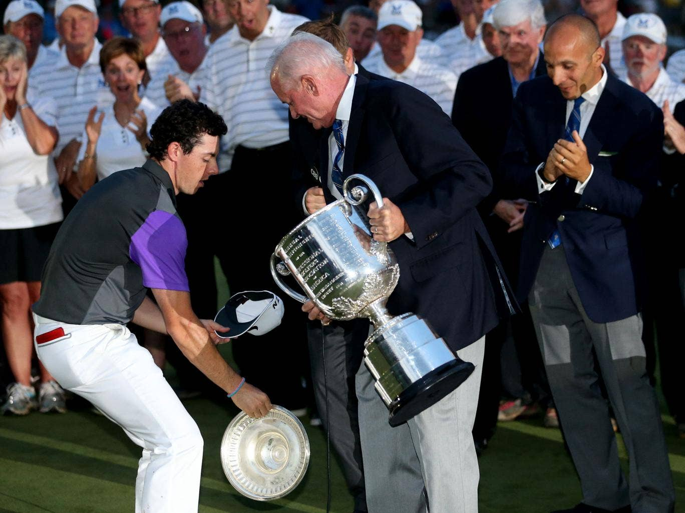 Rory McIlroy catches the lid of the Wanamaker Trophy after winning the US PGA Championship at Valhalla