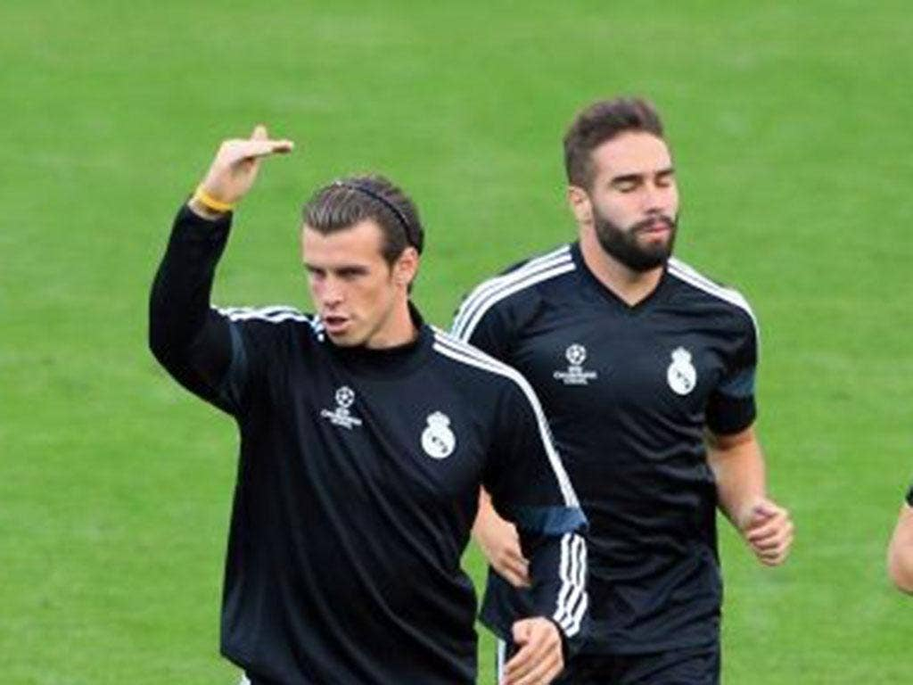 Gareth Bale, left, training with his Real Madrid team-mates at Cardiff City Stadium yesterday