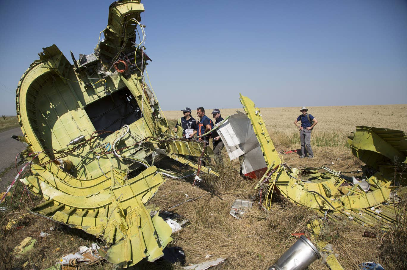 Australian and Dutch investigators examine pieces of the Malaysia Airlines Flight 17 plane crash in the village of Hrabove, Donetsk region, eastern Ukraine