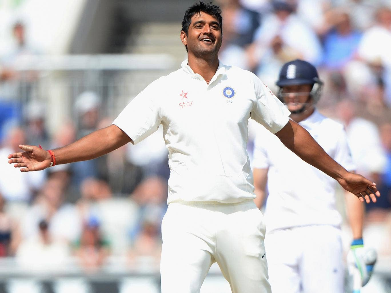 Pankaj Singh, who has begun to enjoy a cult following among cricket devotees, celebrates taking his first Test wicket at Old Trafford last week